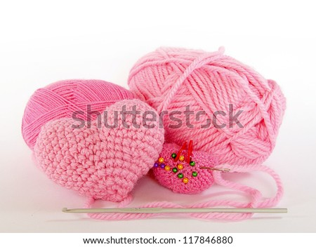 Set for knitting. Skeins of pink yarn to crochet and knitting heart.  Isolated on white background