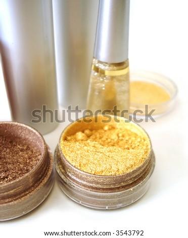 set for make-up (golden eyeshadows, rouge and nail polish) - stock photo