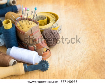 Set for needlework on a wooden background