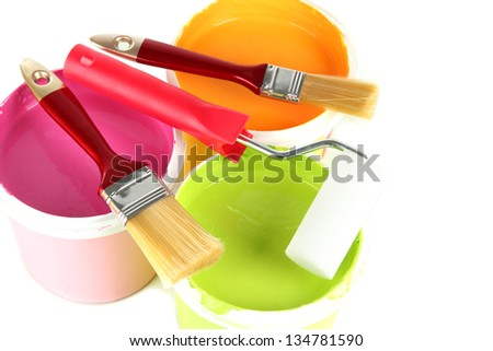 Set for painting: paint pots, brushes, paint-roller isolated on white - stock photo