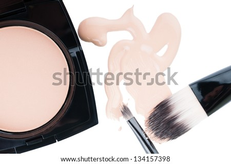 Set for professional make-up with cosmetic liquid foundation, compact powder and brushes on isolated white background
