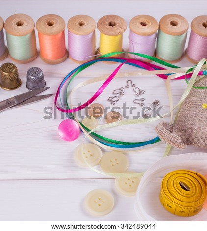 Set for sewing, knitting and needlework on a wooden board in Shabby Chic style