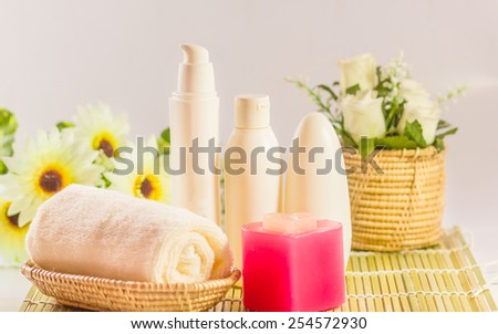 Set for spa in wicker basket, isolated on white backgrounds - stock photo