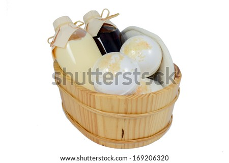 Set for spa-procedures on a wooden bathtub - stock photo