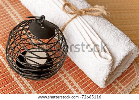 Set for SPA services, ready to use, candle and towel .