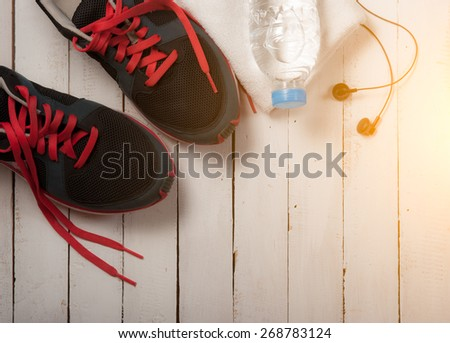 Set for sports activities on white wooden background,morning light - stock photo