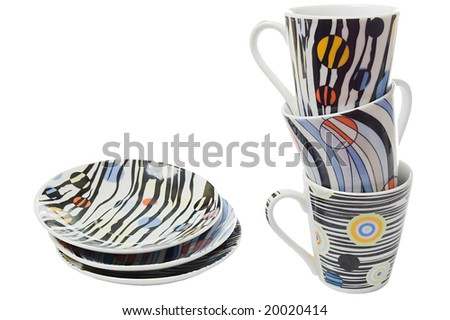 Set for three of colorfull dishes and cups for coffee, isolated on white - stock photo