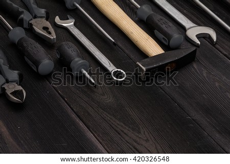 set for tools for car rapair on black floor. Background with tool kit for hard work concept - stock photo