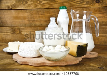 Set from dairy products on wooden table - stock photo