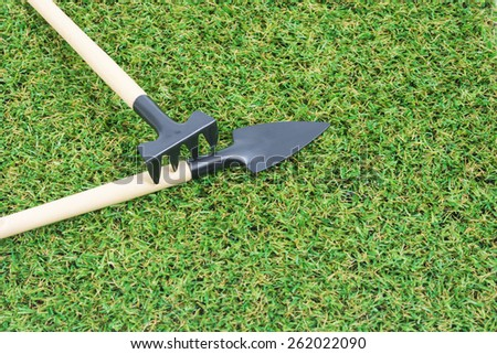 Set gardening tools on green grass background.