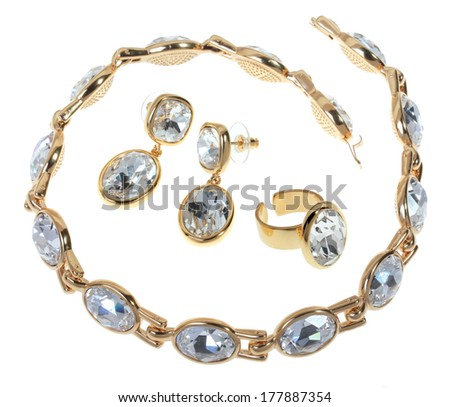 Set gold plated jewelry on a white background