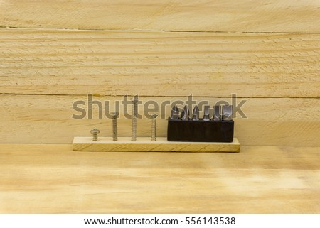 set head screw driver and screw on wood background