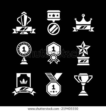 Set icons of awards and trophy isolated on black - stock photo