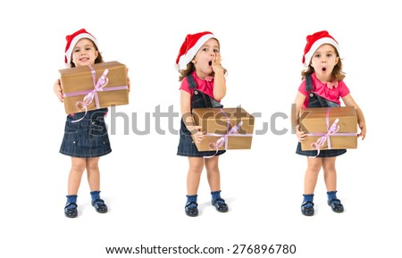 Set images of blonde christmas kid with a gift doing surprise gesture - stock photo