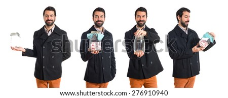 Set images of man holding glass jar with sweets inside - stock photo