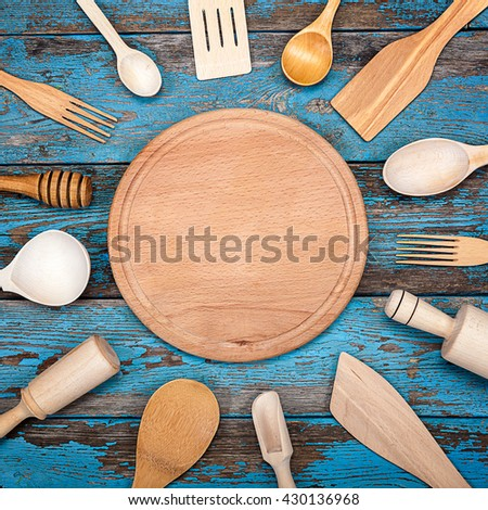 Set kitchen utensils on a wooden background. Accessories for cooking. - stock photo