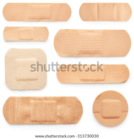 Set of adhesive plasters isolated on white background - stock photo