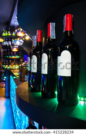 Set of Alcohol bottles with colorful background - stock photo