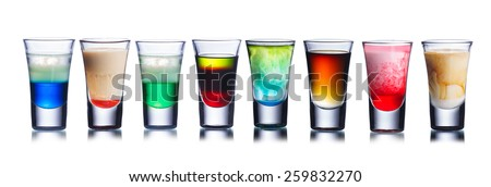Set of alcoholic cocktails in shot glasses (shooters) isolated on white - stock photo