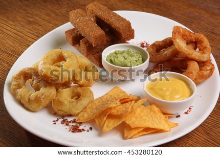 set of appetizers to beer and sauces on plate