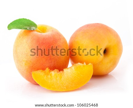 Set of apricot fruits and slices with green leaves, isolated on white background - stock photo