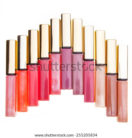 Set of assorted colorful lip gloss tubes - stock photo