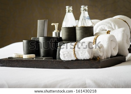 Set of bath accessories on bed - stock photo