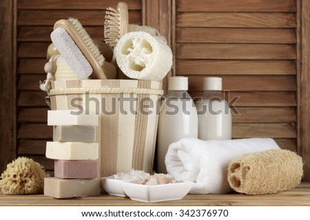 Set of bath accessory in wooden bathroom. - stock photo