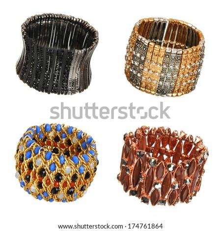 set of beautiful bracelets isolated on white - stock photo
