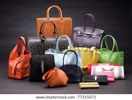 Set of beautiful leather handbags for your choice - stock photo