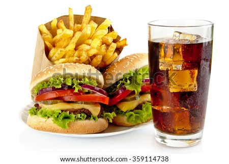 Set of big cheeseburgers with french fries and glass of cola on plate
