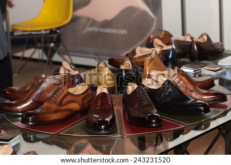 Set of black and brown mens luxury shoes in the store - stock photo