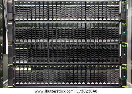 set of black hard drives in the storage system in the data center - stock photo