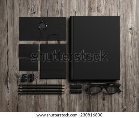 Set of black identity elements on vintage wood background - stock photo