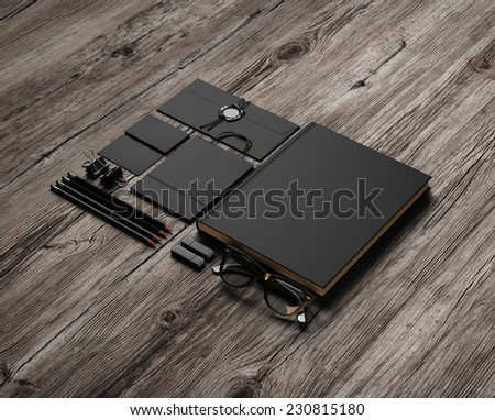 Set of black identity elements on wood background