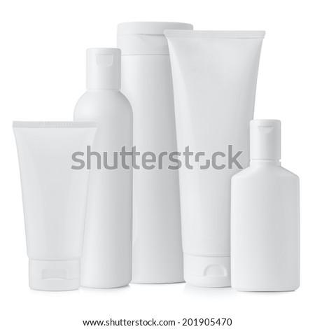 Set of blank white plastic cosmetics bottles isolated on white background - stock photo