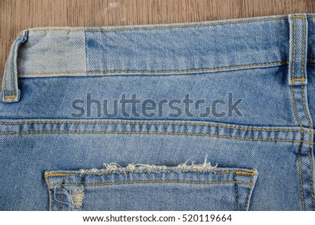 Set of blue jeans background-wooden board