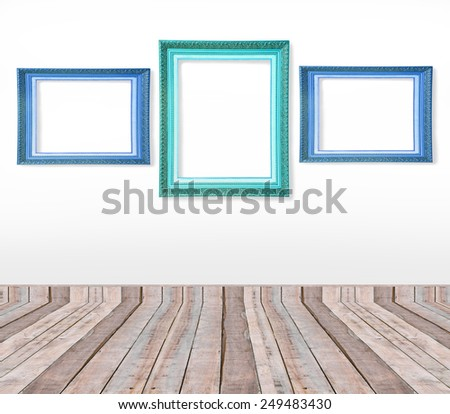 Set of blue vintage picture frames on the wall inside the room - stock photo