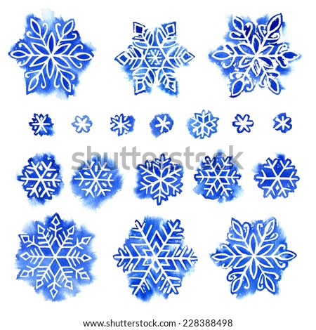set of blue watercolor snowflakes