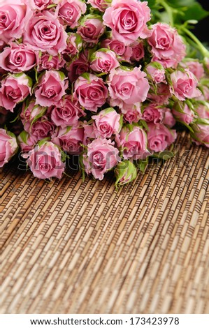 Set of bouquet roses on sackcloth textured   - stock photo