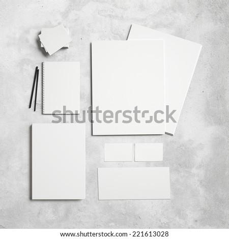 Set of branding elements on concrete background - stock photo