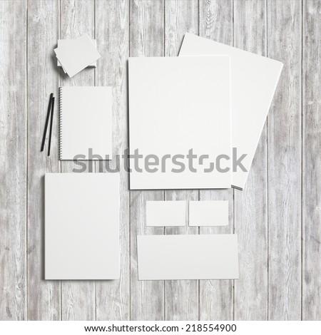 Set of branding elements on wood background - stock photo