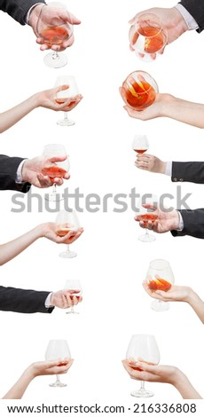 set of brandy glasses in hand isolated on white background - stock photo