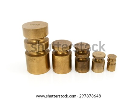 Set of brass metric weights in grams - 500g, 200g, 100g, 50g and 20g metal cylinders - stock photo