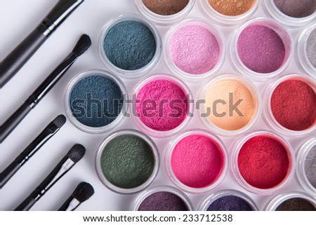 Set of bright mineral eye shadows and brushes, top view  - stock photo