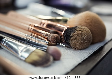 set of brushes for makeup scattered chaotically