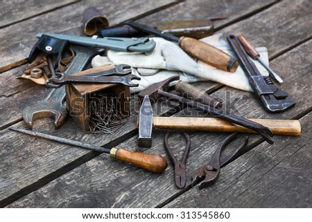 Set of building tools on a wooden background, reference to webtools - stock photo