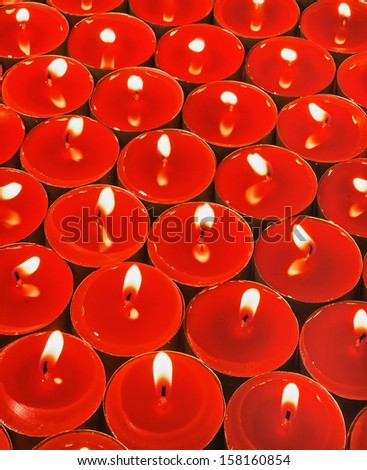 set of burning red candles - stock photo