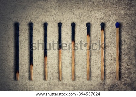 Set of burnt match at different stages, as a financial chart or graph showing business growth. Leadership concept - stock photo