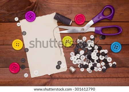 Set of buttons for the repair of clothing and tailoring shears. - stock photo